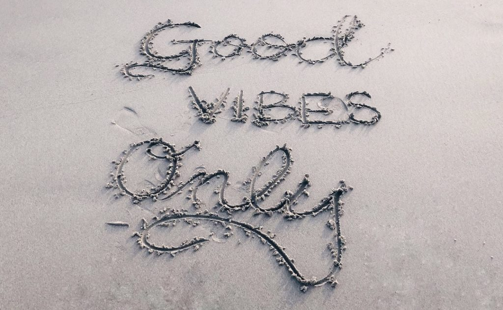 "Image of the words ""Good Vibes Only"" written in sand"