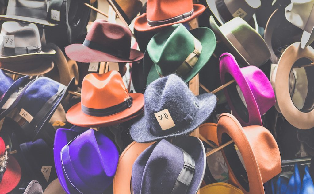 Image of hats for sale on stands