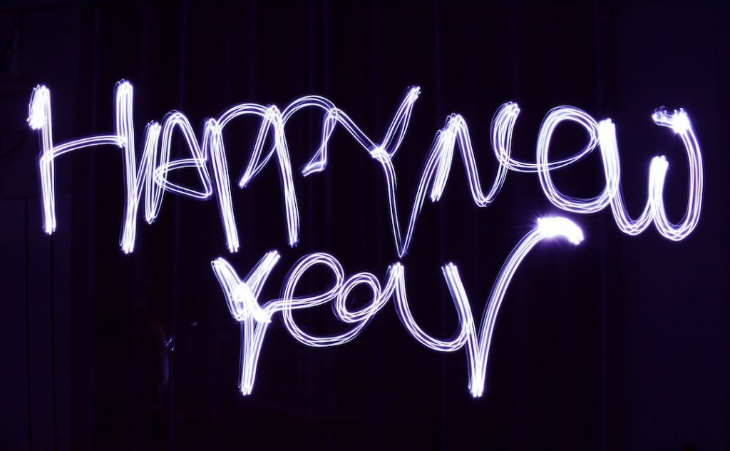 "Image of the words ""happy new year"" illuminated"