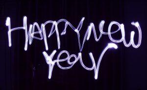 "Image of the words ""happy new year"" illuminated"