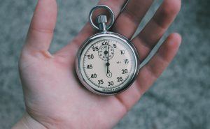 Image of hand holding pocket watch