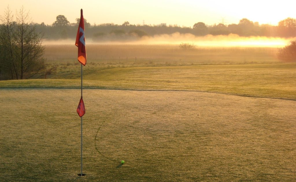 Image of flag on golf course