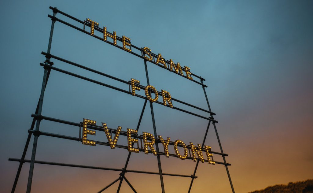 "Image of a sign with the words ""The Same For Everyone"""