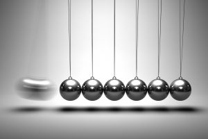 Image of balancing balls Newton's cradle on grey background