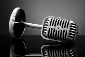 Image of retro microphone on grey